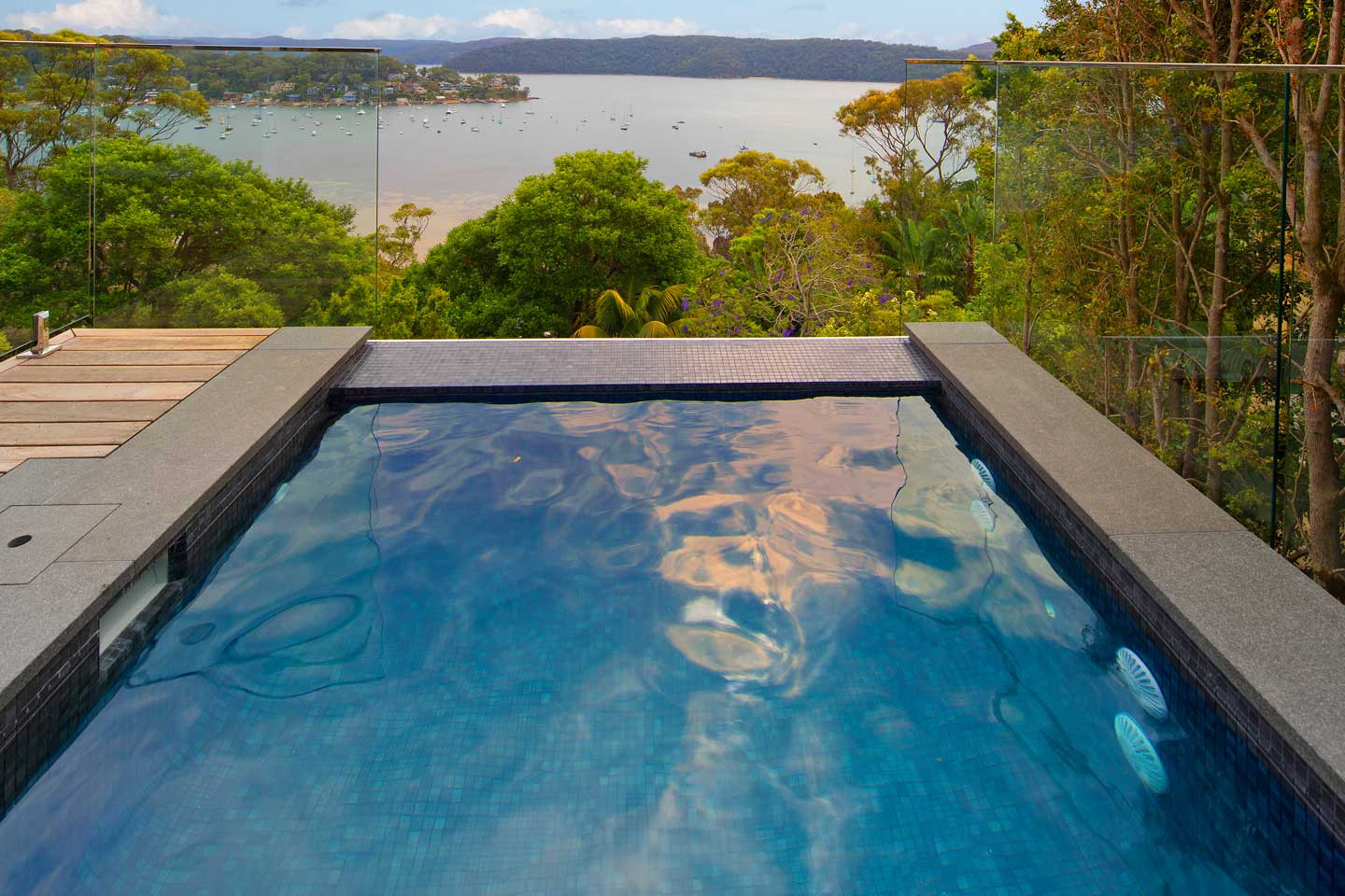 Palm beach plunge pool infinity pools for Infinity swimming pools pictures